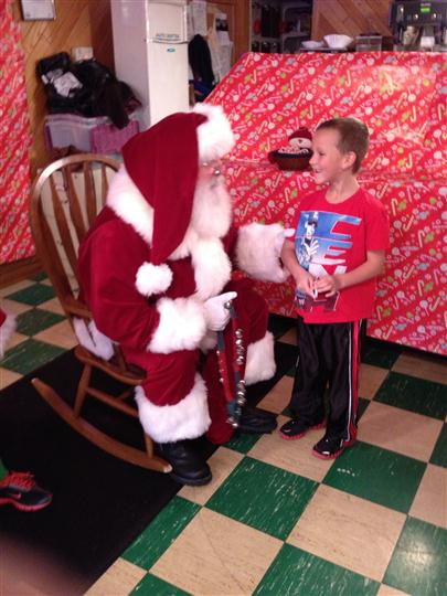 Interior shot of the restaurant with a Santa Claus and a smiling boy