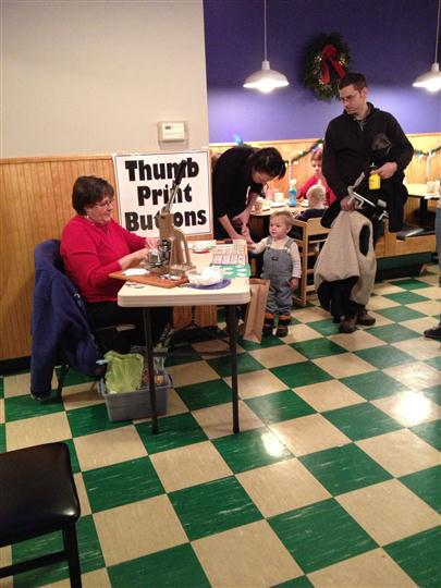 A woman at a thumbprint buttons desk in the restaurant