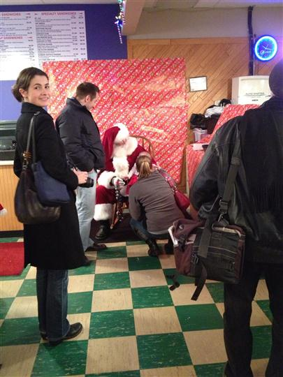 Interior shot of peaple waiting for a photo with Santa Claus