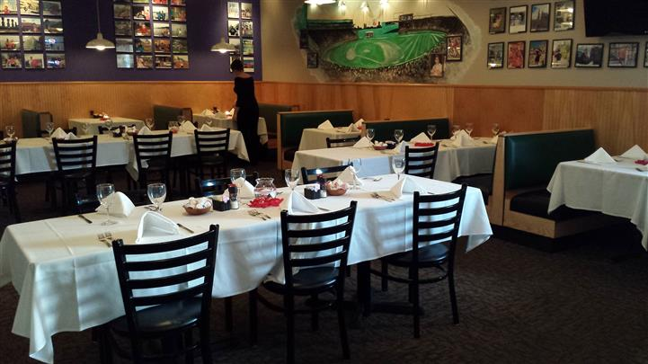 Interior shot of the restaurant's tables with white table cloths