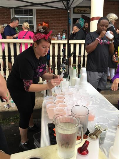 Woman preparing drinks for people in the marathon