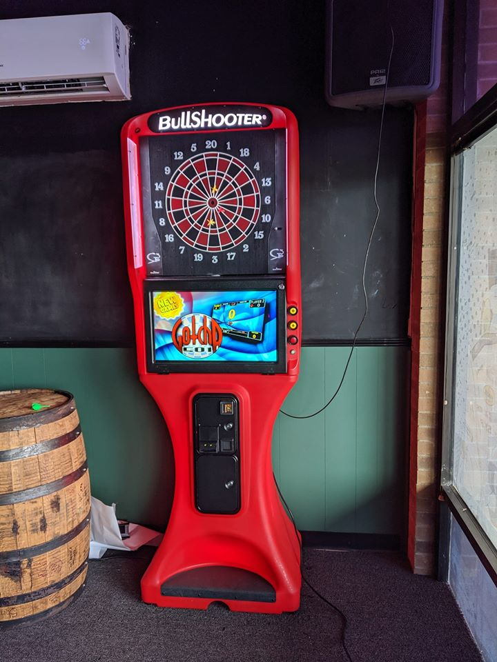 Electronic dartboard inside of a room