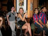 four customers sitting around the bar area