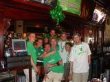 9 friends posing by the bar