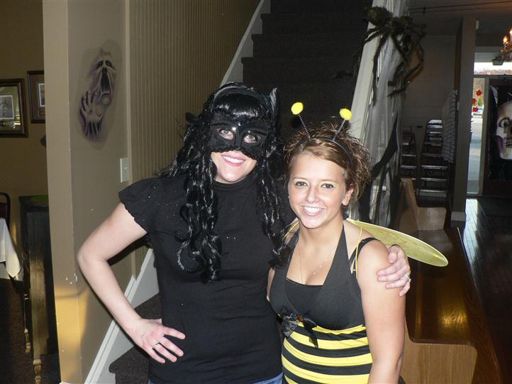 2 ladies in costumes for a photo