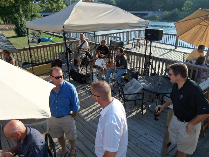 People performing on a outdoor patio