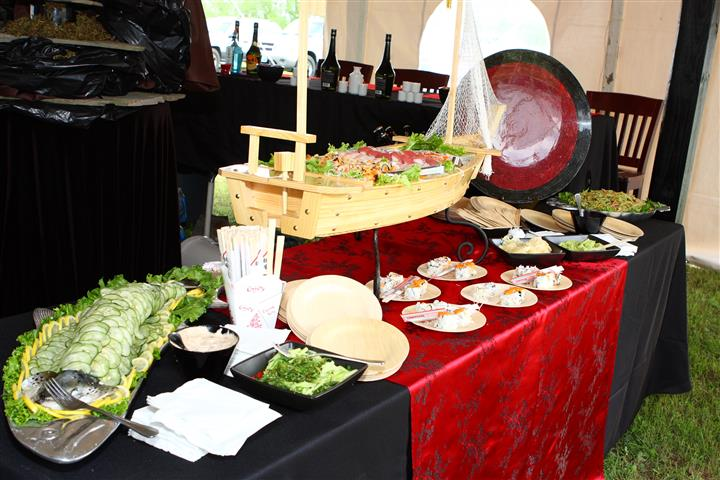 sushi station with chop sticks and chinese to-go boxes