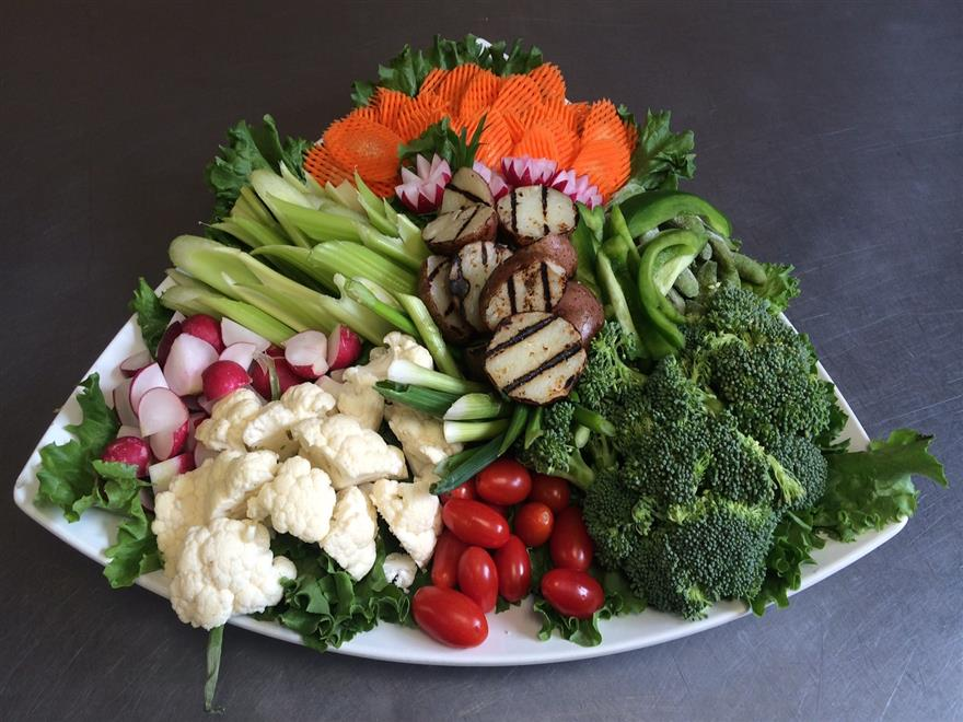vegetable platter including broccoli, tomatos and carrots