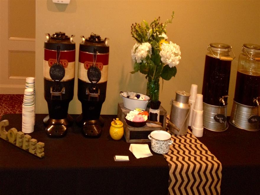 coffee station with 2 thermals and condiments on the side