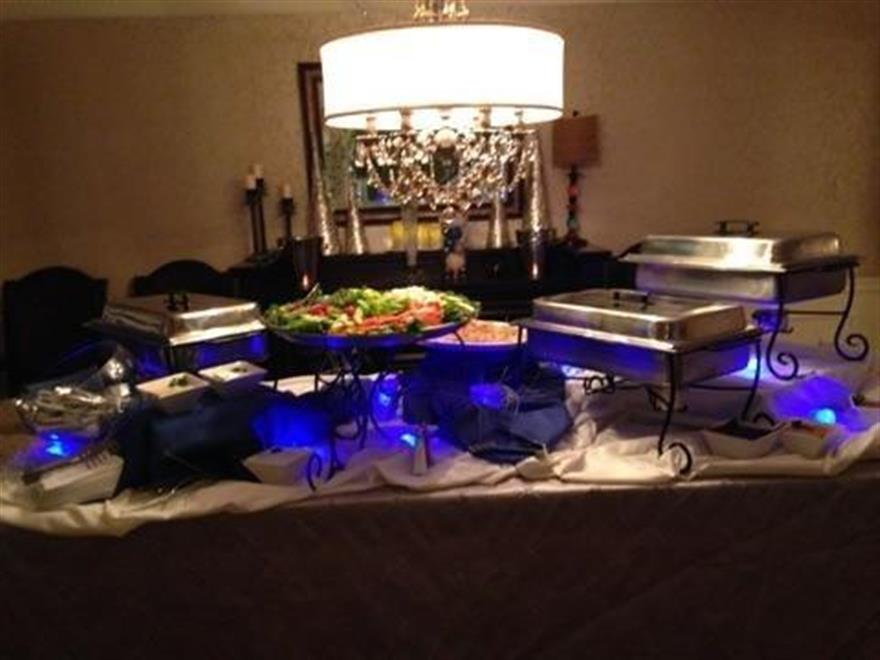 covered food trays on a table at an event