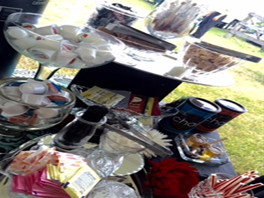 coffee station with a variety of sugars and creamers