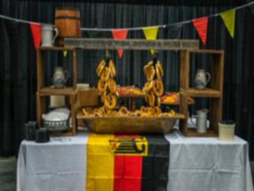 decorated food station with yellow, black, and red.