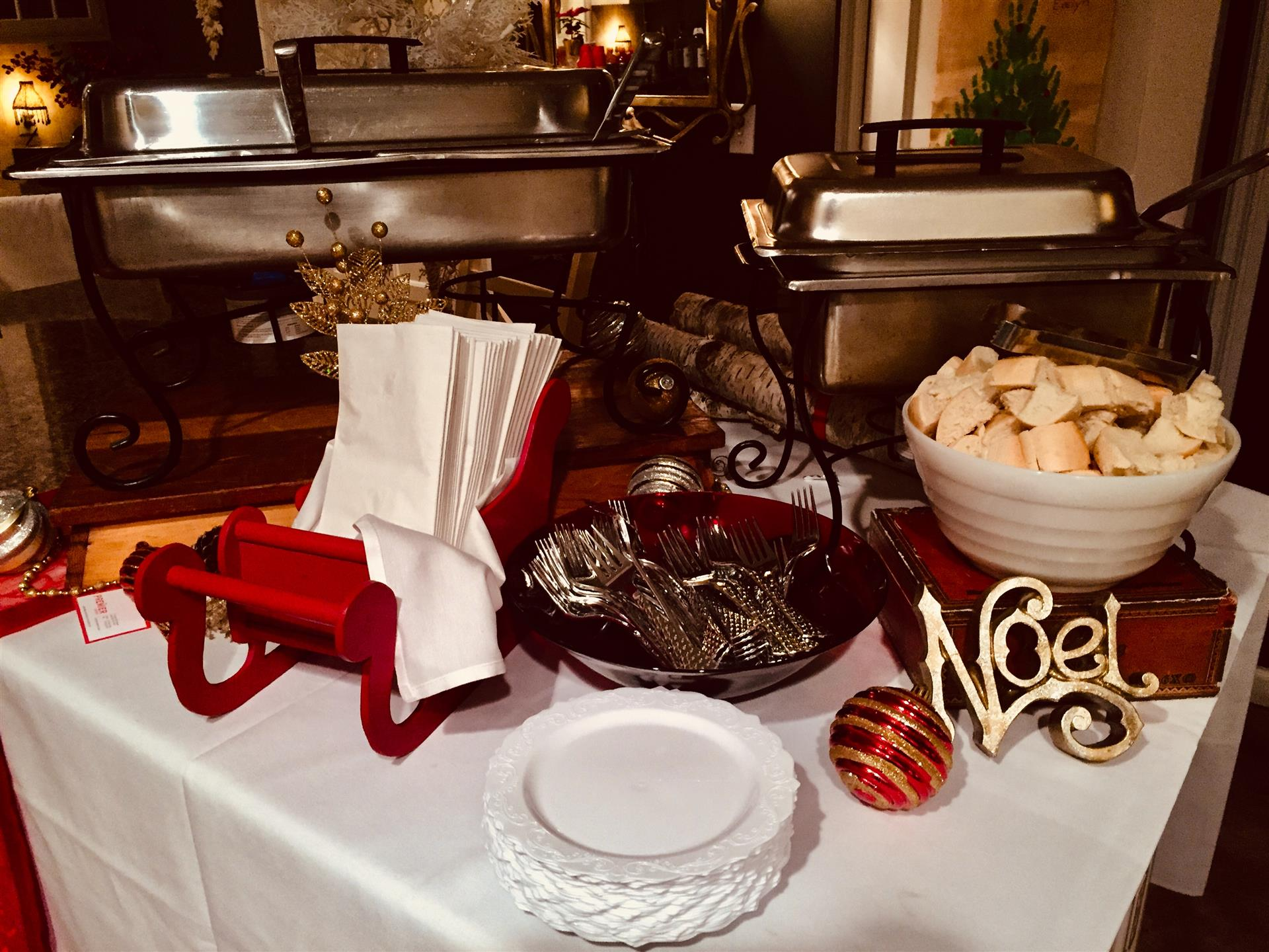 Christmas decorations with napkins and silverware inside