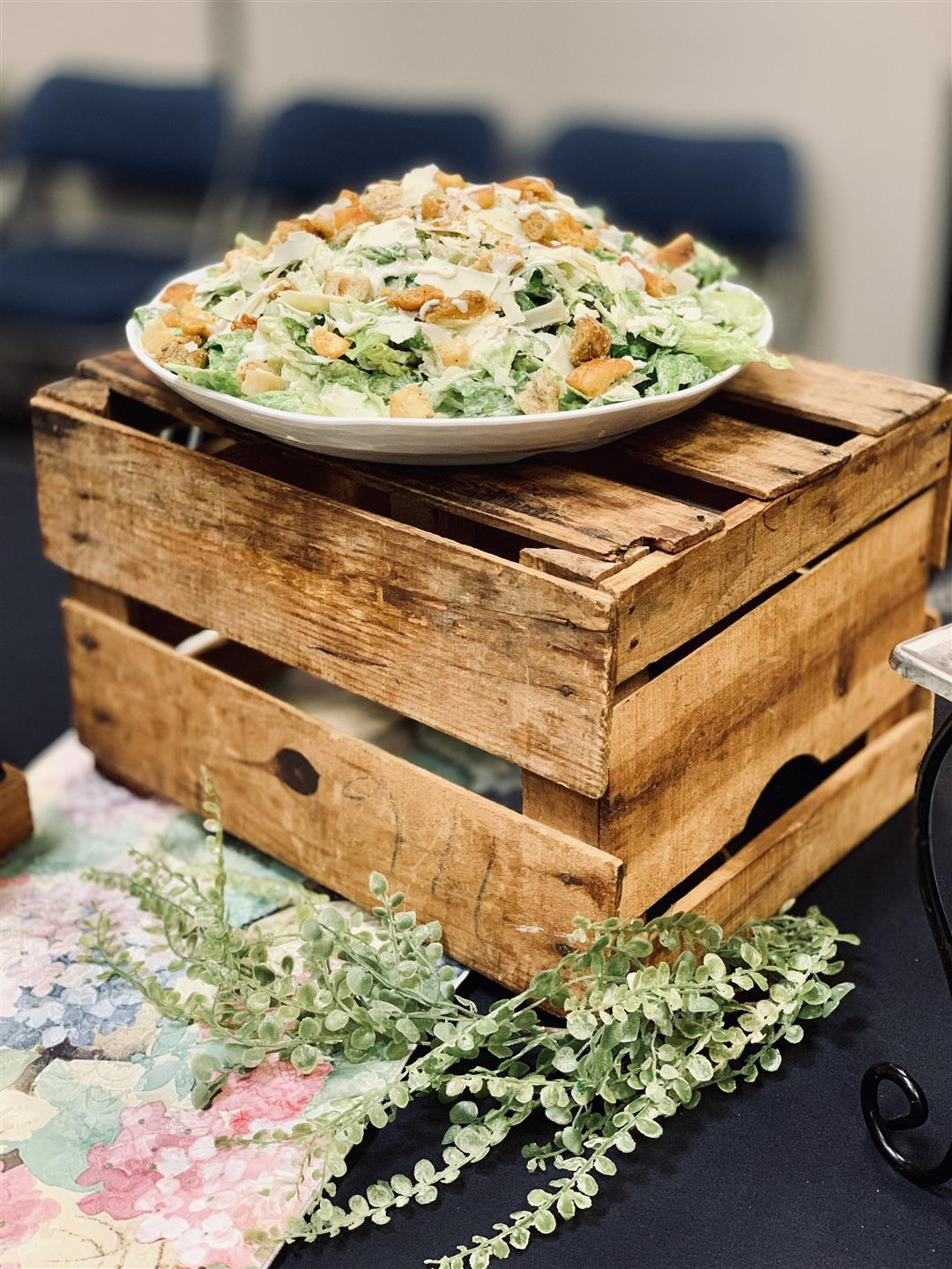 caesar salad on top of a wooden crate