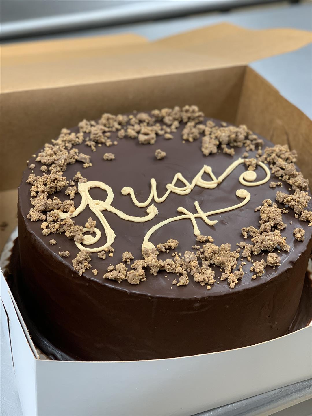 chocolate cake with the name Russ written on top