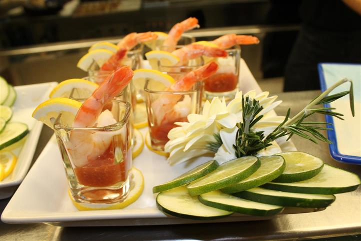 Shrimp cocktail with lemons, cucumbers, limes