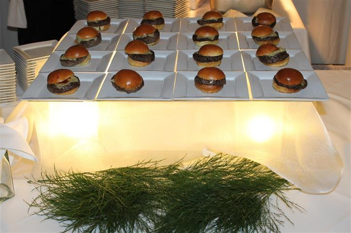 Sliders on square dishes on top of table