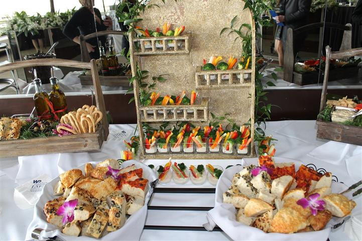 Hors d'oeuvres, vegetables, breads displayed on table