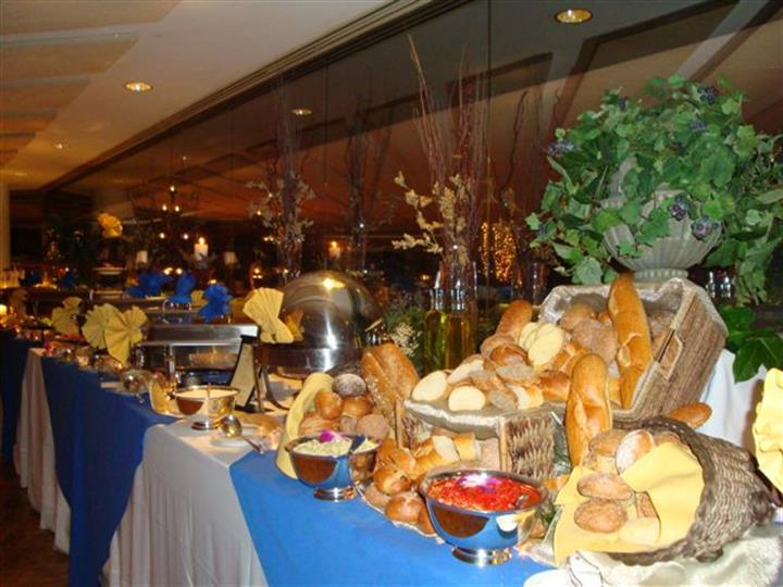 Buffet table with baskets of bread and sternos