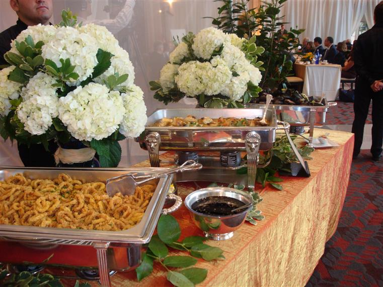 Chafing dishes and flowers on covered table