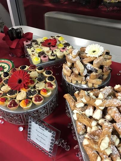 assortment of various desserts such as cannolis, mini pies and cookies