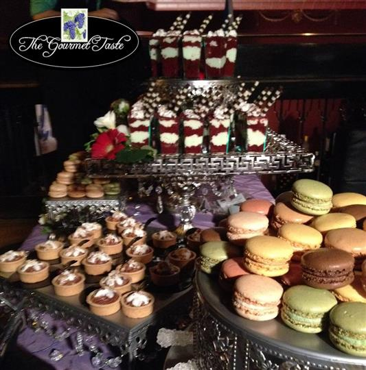 assortment of various desserts such as macaroons, mini chocllate mousse pies and cookies
