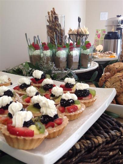 assortment of various desserts such as pudding, mini pies and cookies