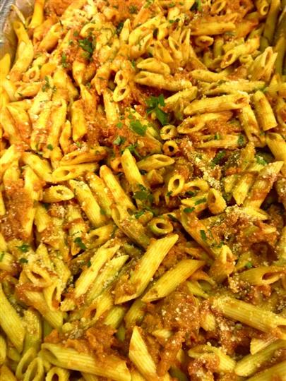 cooked pasta with sauce and herbs