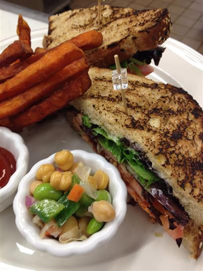 blt sandwich with a side of chick pea salad and vegetables