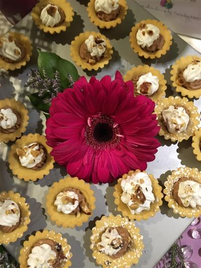 mini chocolate mousse muffin desserts with whipped cream and nuts