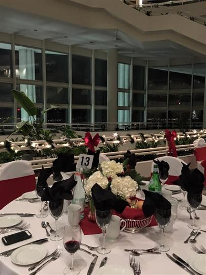catering setup with tables, chairs and a buffet station