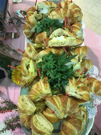 catering assortment of croissants filled with tuna salad