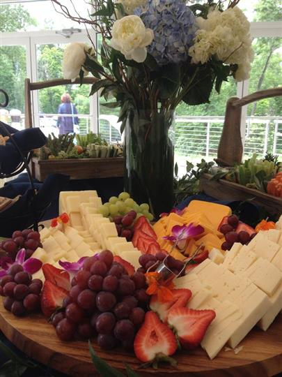 Assorted fruit and cheese station on display table