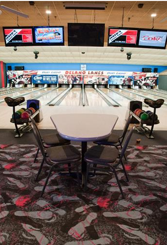 tables and chairs set up inside bowling alley
