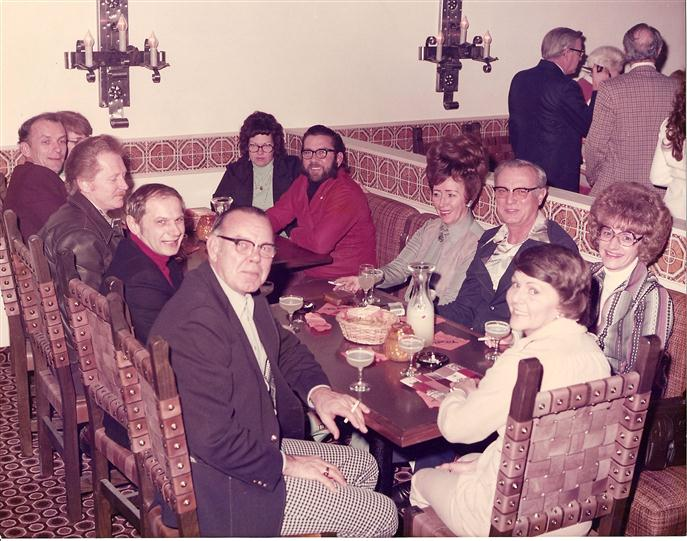 vintage image of a family eating at a table with drinks