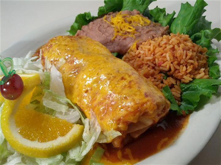 Chimichango with a side salad, rice and beans