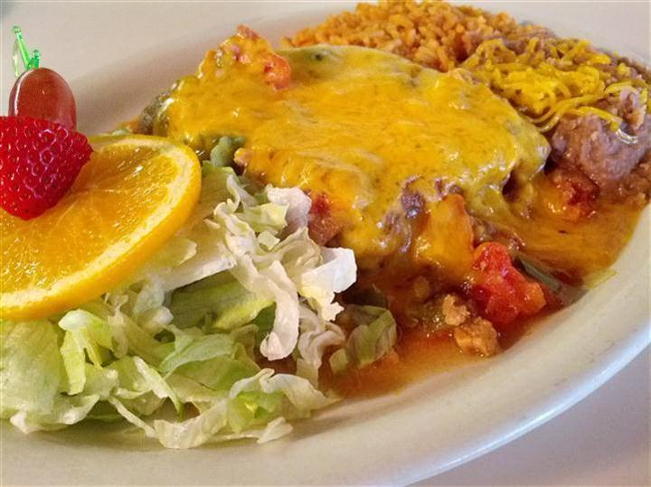 enchilada with salad and rice