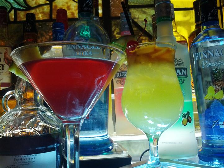 various mixed drinks displayed at the bar