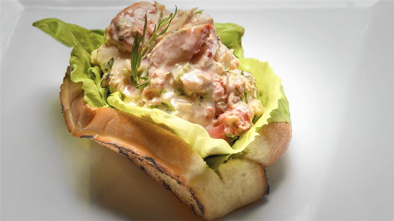lobster roll with lettuce on a toasted bun