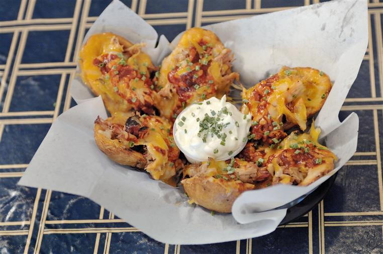 fried potato skins topped with pulled pork, bbq sauce, and shredded cheese.  served with sour cream and chives