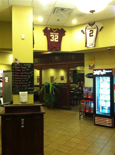 Entrance of the dining area with 2 jersey's hanging on the wall
