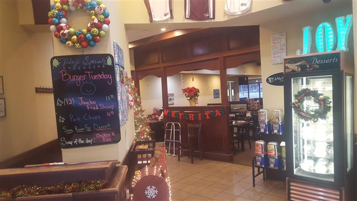 Entrance of dining area with Christmas decorations up.