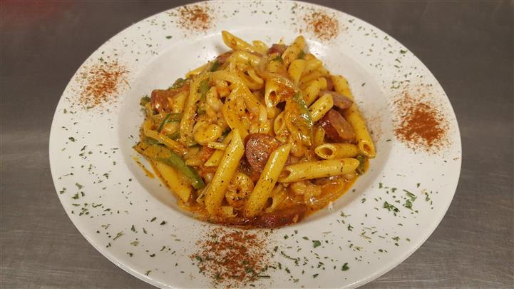 Rigate pasta served with chopped sausage and veggies