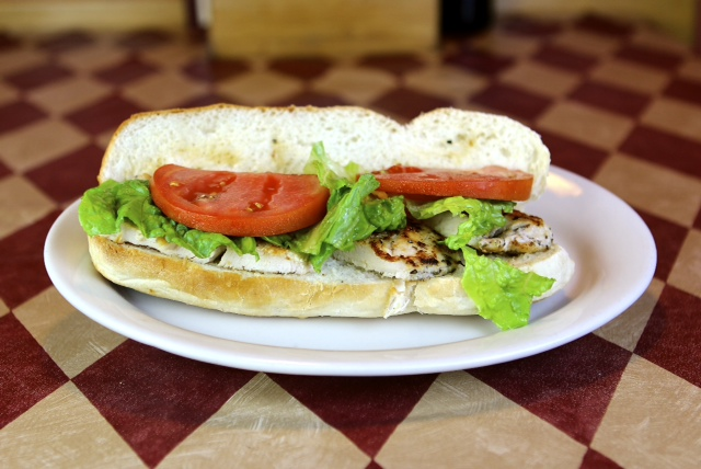 a sub with grilled chicken, lettuce and tomato
