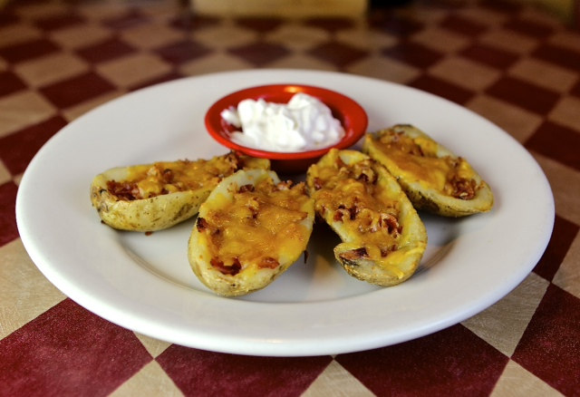 loaded potato skins with a side of dip