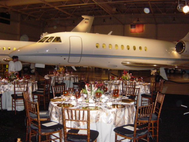several tables in front of a plane