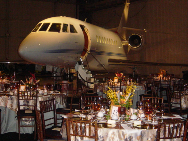 catering table in front of a plane