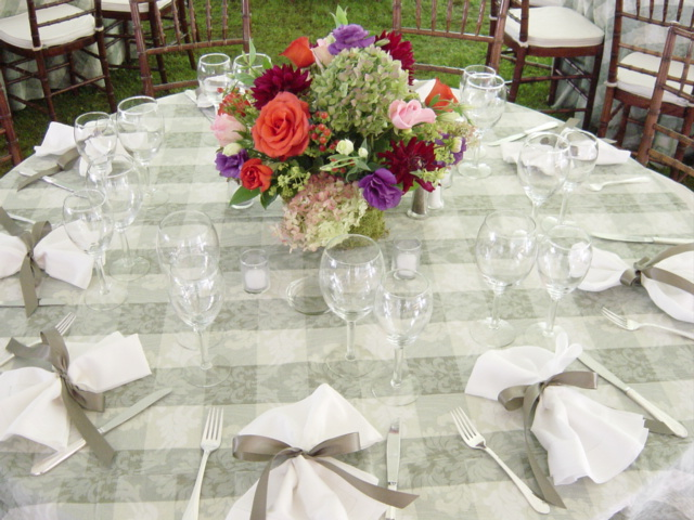 floral arrangement in the middle of a decorated table