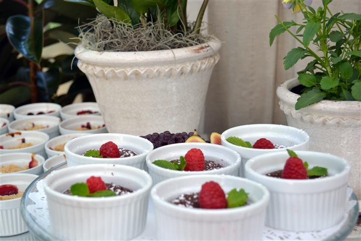 dessert topped with raspberries and garnish