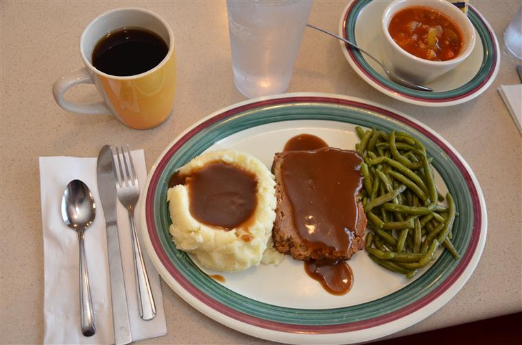 meatloaf with gravy, mashed potatoes and gravy abd stering beans